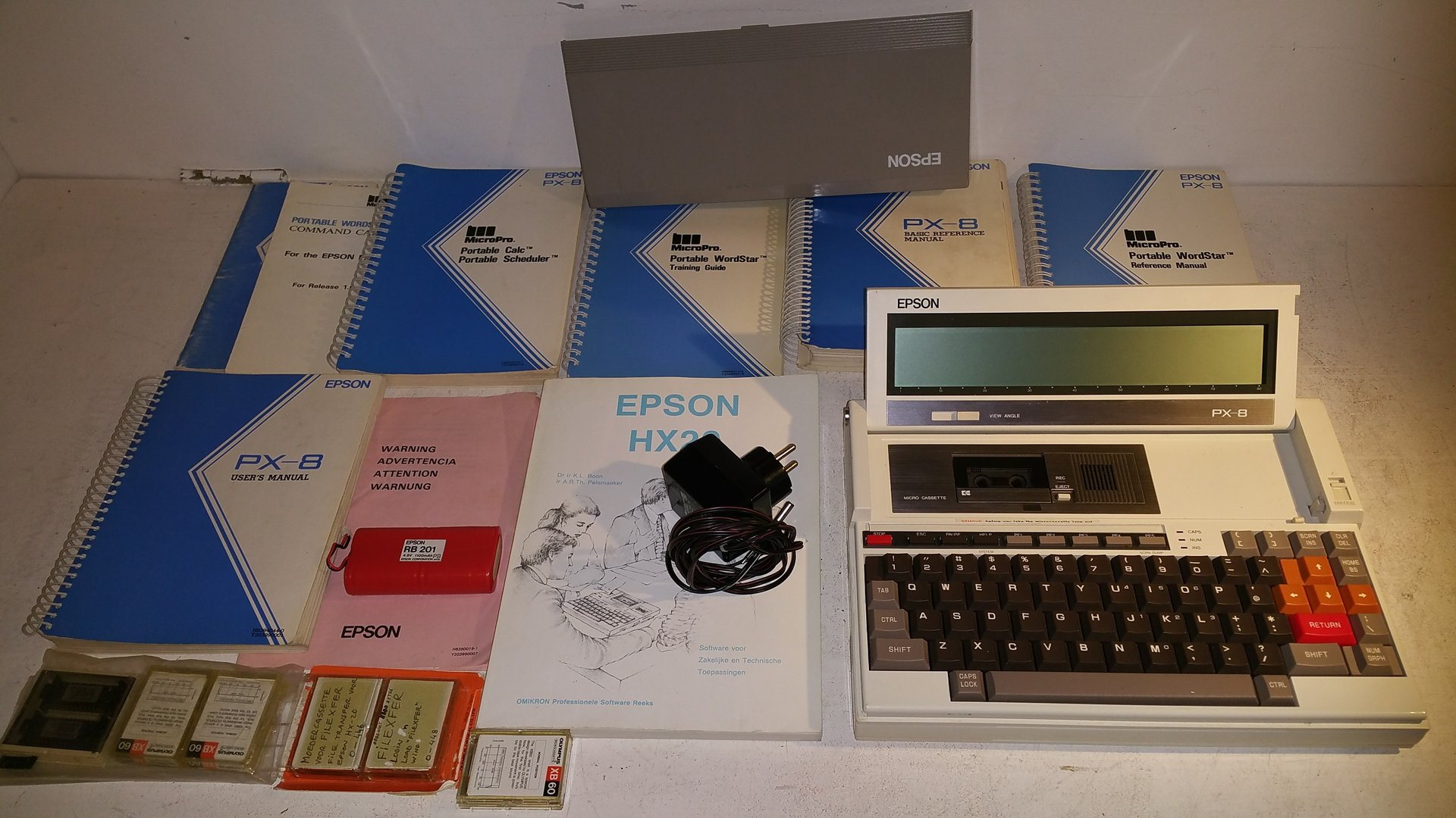 Epson PX-8 Vintage Laptop Computer with loads of books, tapes, chips, etc. Very Nice Condition